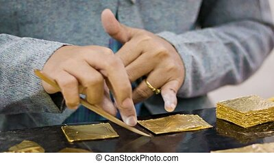 Manufacturing a gold sheets used for gilding - Video 1080p -...