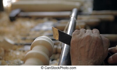 Manufacturing of a traditional toy on a lathe machine