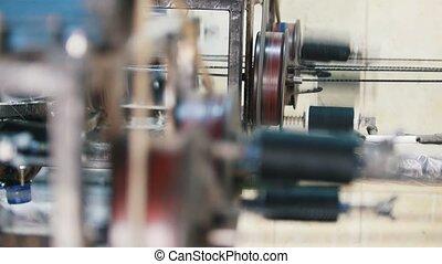 Manufacturing of fiberglass reinforcement - machine is...