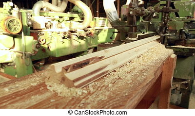 Manufacturing of profile timber at sawmill, close-up