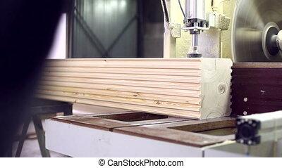 Manufacturing of profiled bar at sawmill. View, close-up