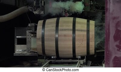 manufacturing wine barrels - drilling and hole burning to...