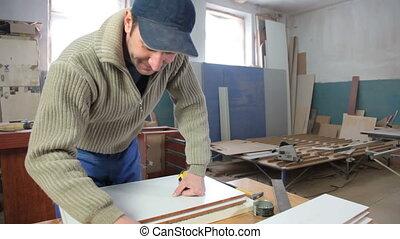 Manufacturing wooden furniture in workshop