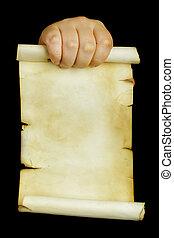 Hand holding old manuscript over black background
