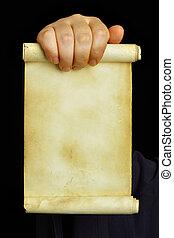 Manuscript - Hand holding old manuscript over black ...