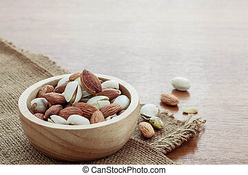 Many almonds in a bowl.