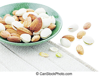 Many almonds on a plate.