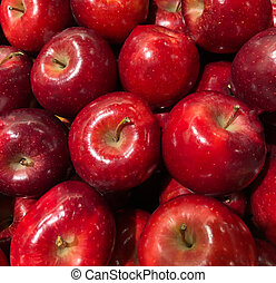 many apples on display in a supermarket