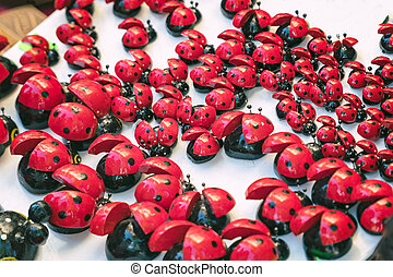 Many artificial lady bug toy. Selective focus