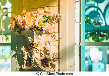 Many artificial pink and white roses are decorated on the wall to the backdrop in the wedding day. Beautiful flowers background, Selective focus.