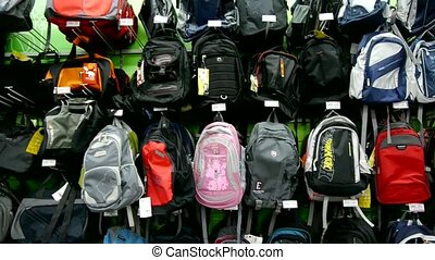 Many backpack on the counter at mall.