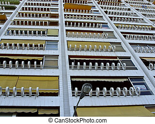 Many Balconies Yellow Blinds