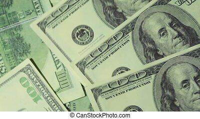 Many banknote hundred dollars turn in two levels - Closeup...