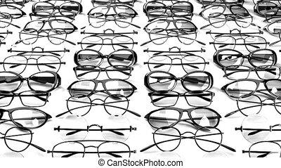Many black glasses on white background