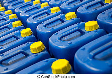 Many Blue Fuel Tanks With Yellow Caps