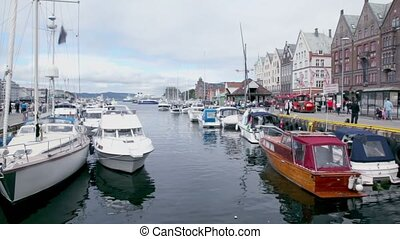 Many boats are in dock of coastal town Bergen at bay Vagen,...