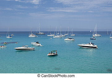 Many boats moored on the blue and green sea - Formentera,...