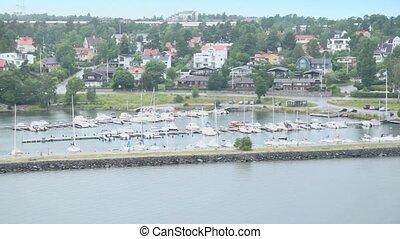 Many boats on moorage at coastal village near Stockholm -...