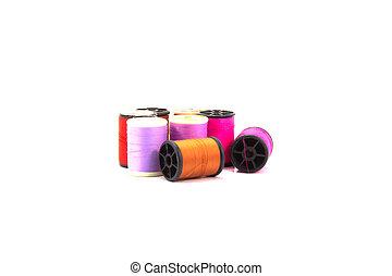 Many bobbins of thread isolated