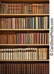 many books - bookcase with many old books in a library