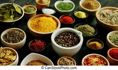 Many bowls with different spices - From above view of many...