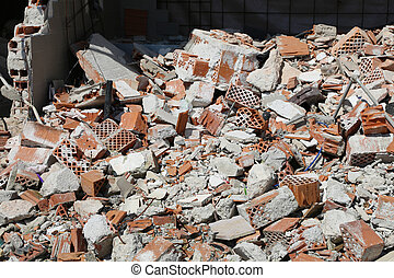 bricks of a completely destroyed wall of a house