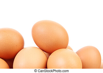 Many brown eggs. Isolated on a white background