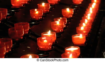 Many burning candles in christian church.Many Candles Are...