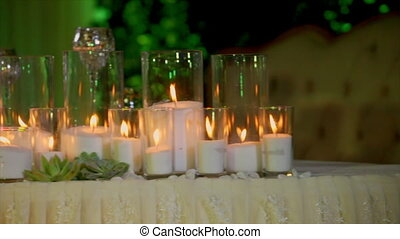Many Burning Candles in Transparent Glasses