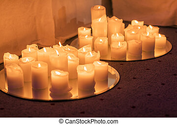 Many burning candles - Light of candels in the church