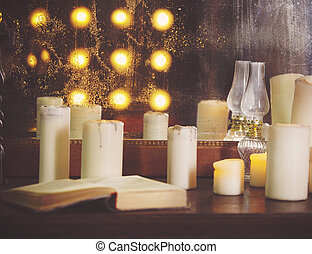Many burning candles on a mirrored background
