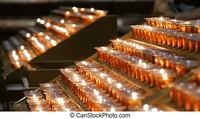 Many burning candles with shallow depth of field candles in...