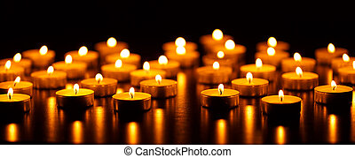 Many burning candles with shallow depth of field - peace ...