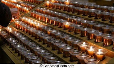 Many burning candles with shallow depth of field