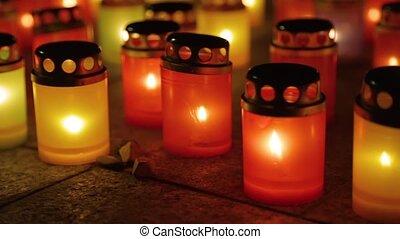 Many burning lanterns on memory, close up footage