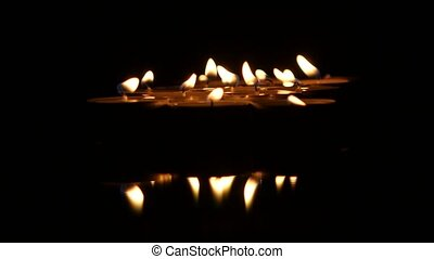 Many burning small candles. Close up - Beautiful candle on...
