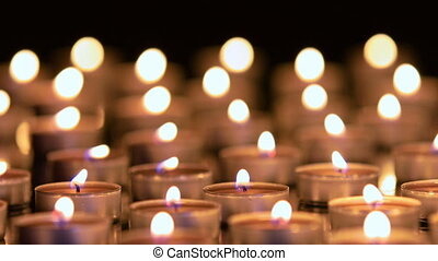 Many candles burning with shallow depth of field - Dolly...