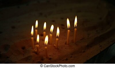many candles in the church on the sand