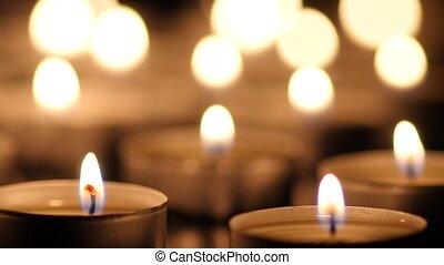 Many Candles light on black background
