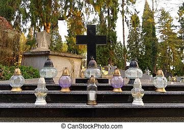 many candles on the grave