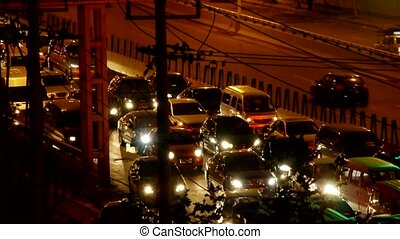 Many cars on overpass, traffic jam at night.
