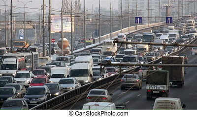 Many cars on road in winter Russia