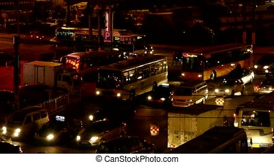 Many cars on road, traffic jam at night, crossroads, junctions.