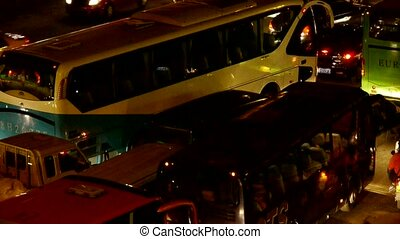 Many cars on road, traffic jam at night.