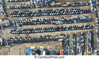 Many cars parked distributed in used car auction lot