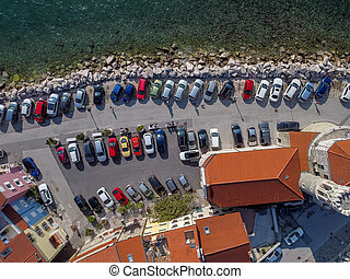 many cars parking in old resort red roofs town