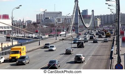 Many cars ride over Crimean Bridge in Moscow at sunny winter...