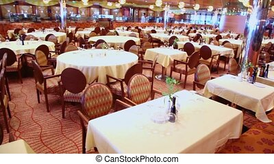 Many chairs and tables in empty restaurant, around motion