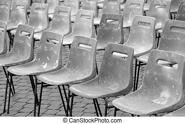 many chairs without people in black and white effect