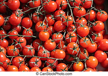 many cherry tomatoes at market